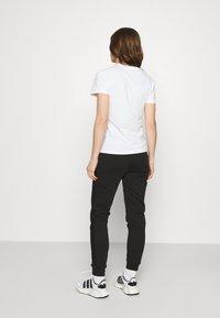 Calvin Klein Jeans - LOGO PANTS - Tracksuit bottoms - black - 2
