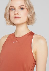 Nike Performance - TANK ALL OVER  - Sports shirt - dusty peach/echo pink - 4