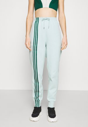 Ivy Park 3 Stripe  - Tracksuit bottoms - greentint/darkgreen