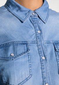 Vila - VIBISTA DENIM SHIRT - Button-down blouse - medium blue denim - 4