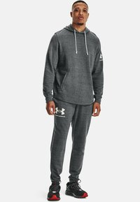 Under Armour - RIVAL TERRY  - Tracksuit bottoms - pitch gray full heather - 1