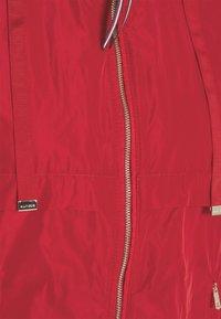 Tommy Hilfiger - WINDBREAKER - Winter jacket - primary red - 2