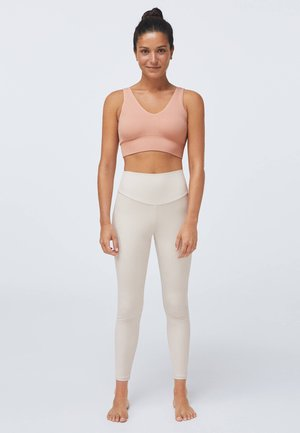 SEAMLESS - Sports bra - rose