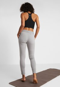 Free People - SUNNY SKINNY - Tracksuit bottoms - grey combo - 2