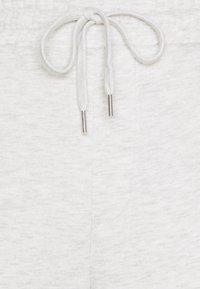 Jack & Jones - JJITOBIAS PANTS UNISEX - Tracksuit bottoms - white melange - 4