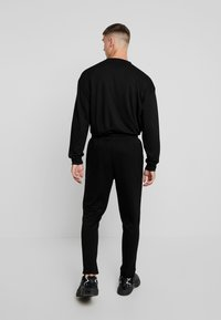 Urban Classics - TERRY TAPERED - Tracksuit bottoms - black - 2