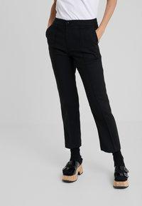 McQ Alexander McQueen - CIGARETTES PANTS - Bukse - black - 0