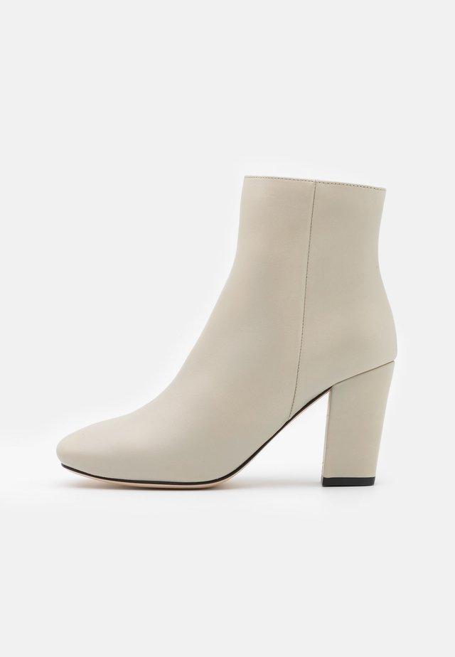 Korte laarzen - avorio