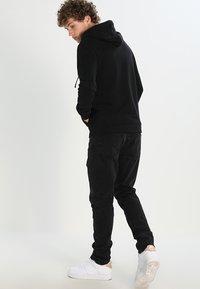 AllSaints - RAVEN - Zip-up hoodie - black - 2