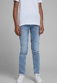 Jack & Jones Junior - Slim fit jeans - blue denim - 1