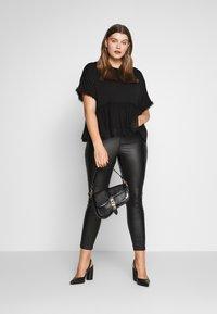 New Look Curves - FLOCKED PEPLUM - T-shirts med print - black - 1