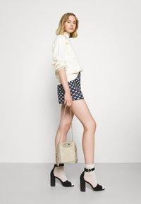 maje - IONALA - Trousers - marine - 4
