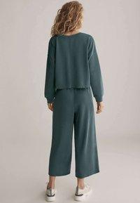 OYSHO - Trousers - green - 2