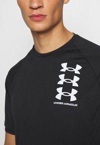 Under Armour - T-shirt imprimé - black - 5