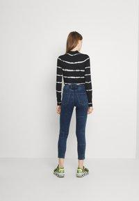 Diesel - BABHILA - Slim fit jeans - medium blue - 2
