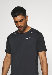 Nike Performance - Triko spotiskem - black - 3