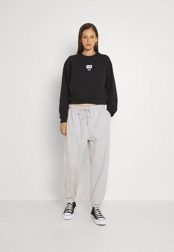Pantalones deportivos - orbit heather gray