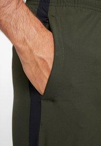 Nike Performance - RUN STRIPE PANT - Träningsbyxor - sequoia/reflective silver - 3