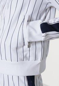 Fila - HALA TRACK JACKET - Summer jacket - blanc de blanc/black iris - 4