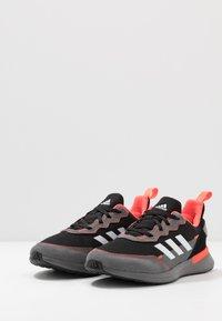 adidas Performance - RAPIDARUN ELITE - Hardloopschoenen neutraal - core black/footwear white/solar red - 3