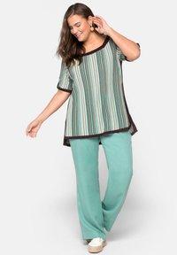Sheego - Print T-shirt - green - 1