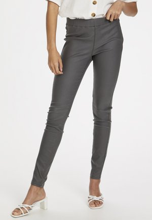 ADA COATED - Leggings - Trousers - rawhide