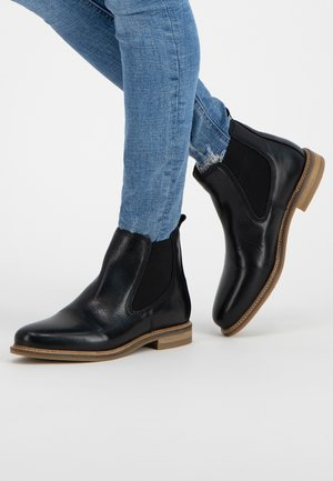 PARIS - Ankle boots - black
