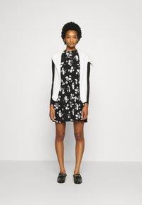 Calvin Klein Jeans - FLORAL DRESS - Day dress - black - 1