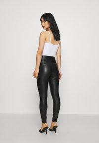 VILA PETITE - VINNIS COATED  - Leggings - Trousers - black - 2