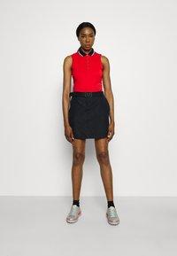 Under Armour - LINKS PRINTED SKORT - Sports skirt - black - 1