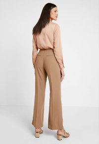 Dorothy Perkins - BOOTCUT - Trousers - light brown - 2