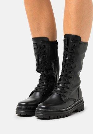 Šněrovací vysoké boty - schwarz/weiss