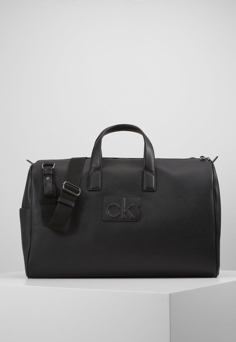 Calvin Klein - CENTRAL WEEKENDER - Weekend bag - black