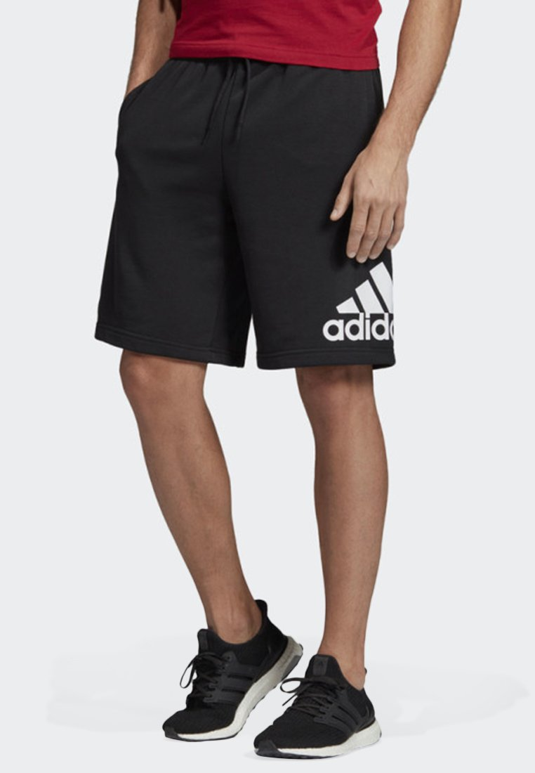 adidas Performance - MUST HAVES BADGE OF SPORT SHORTS - Sports shorts - black