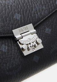 MCM - MILLIE CROSSBODY IN VISETOS - Across body bag - black - 4