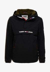 Tommy Jeans - PADDED POPOVER - Light jacket - black - 4