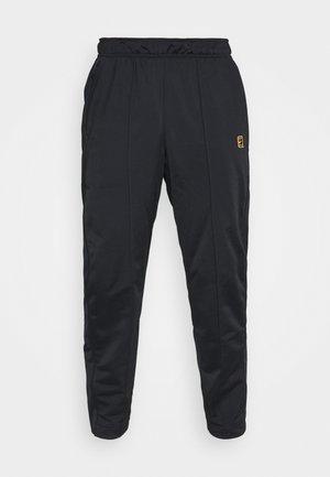 HERITAGE SUIT PANT - Verryttelyhousut - black