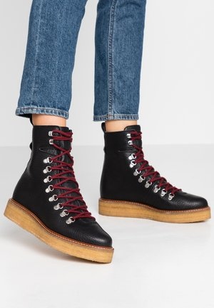 BORDER COMBAT BOOT - Platform ankle boots - black
