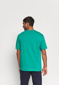 Diadora - SHIELD - T-shirt med print - green shadow - 2