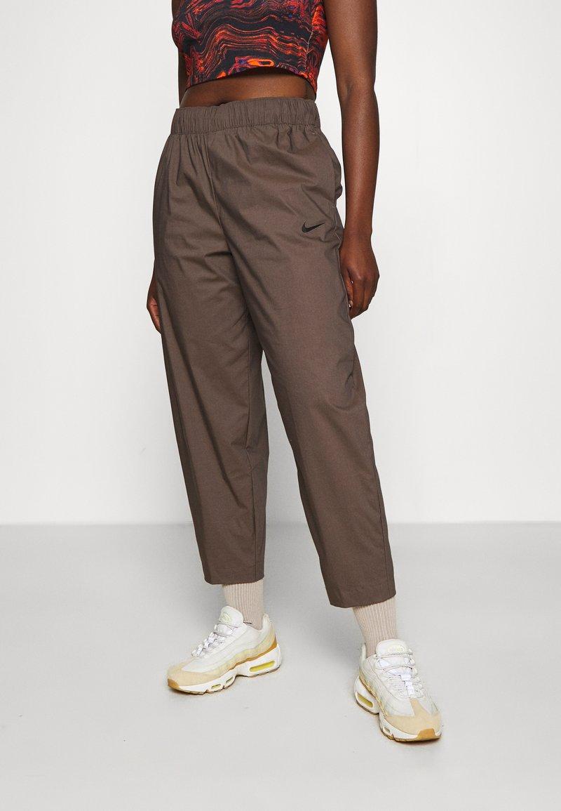 Nike Sportswear - Tracksuit bottoms - ironstone/black