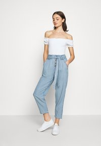 American Eagle - BUTTON FRONT PAPERBAG TAPER PANTS - Trousers - light blue - 1