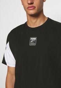 Puma - REBEL ADVANCED TEE - Print T-shirt - puma black - 5