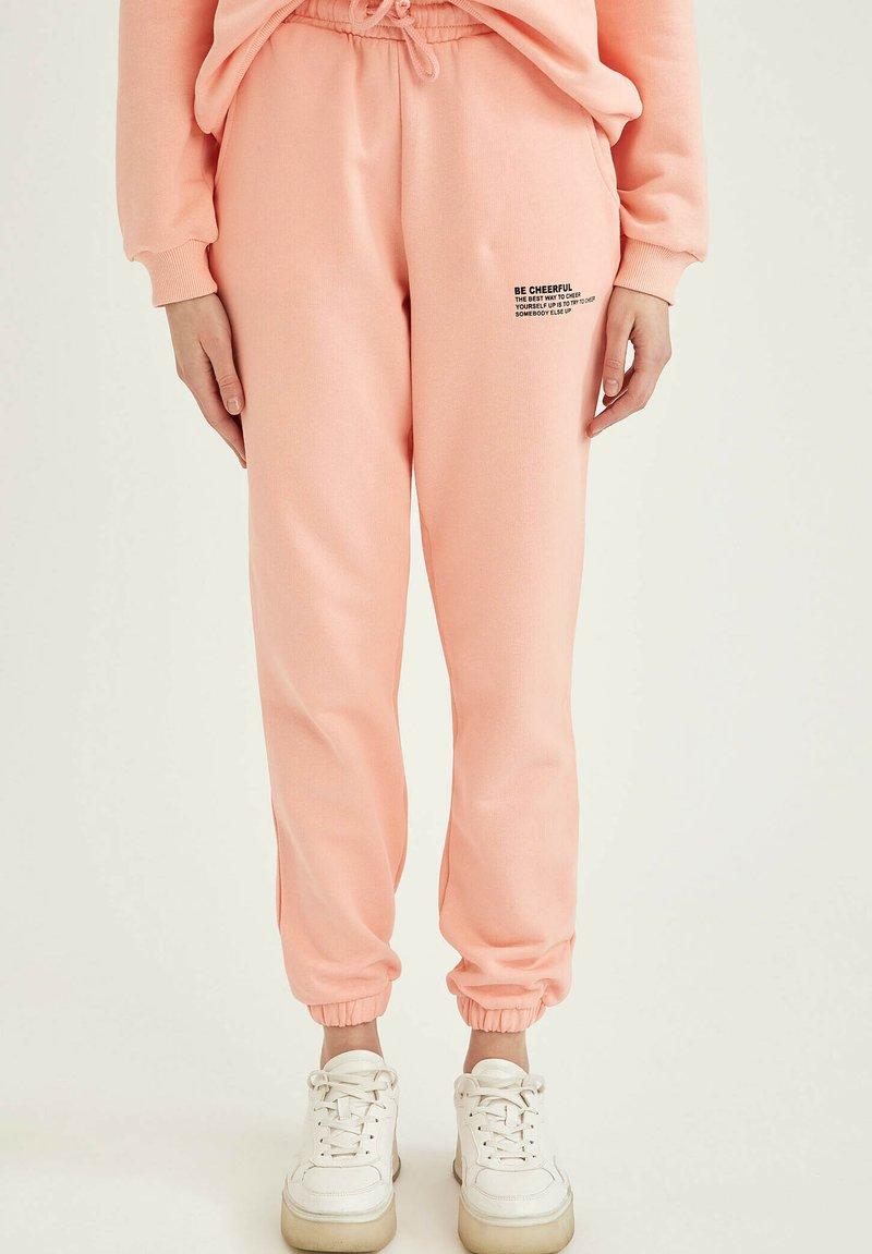 DeFacto Fit - Tracksuit bottoms - pink