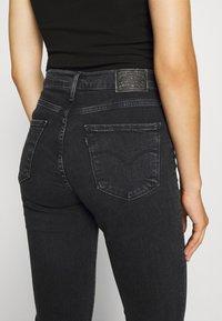 Levi's® - 724 HIRISE STRAIGHT CROP - Straight leg jeans - black denim - 7