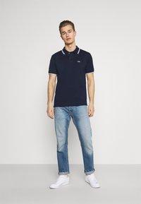 Lacoste - Polo shirt - navy blue/white - 1