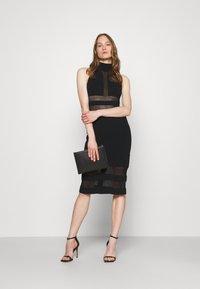 Hervé Léger - HERVE LEGER X JULIA RESTOIN ROITFELD HALTER COLUMN DRESS - Cocktail dress / Party dress - black - 1