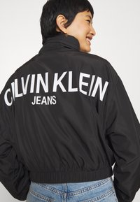 Calvin Klein Jeans - BACK LOGO - Windbreaker - black