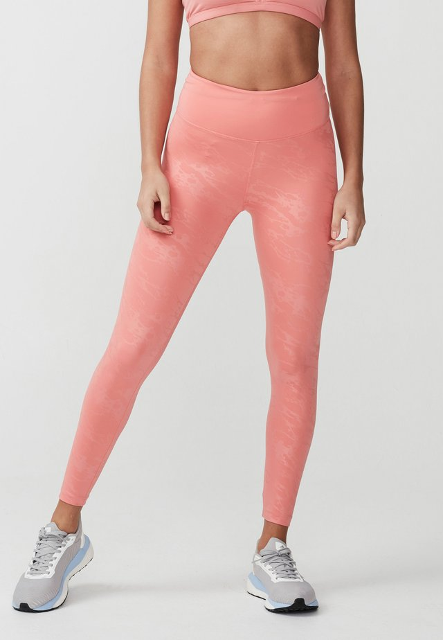 GLOSS EFFECT - Leggings - embossed peach stream
