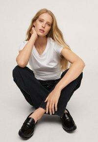Mango - Straight leg jeans - black denim - 4