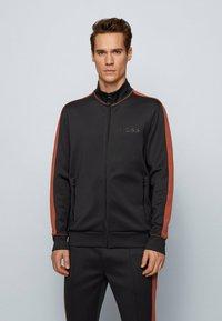 BOSS - Zip-up hoodie - black - 0